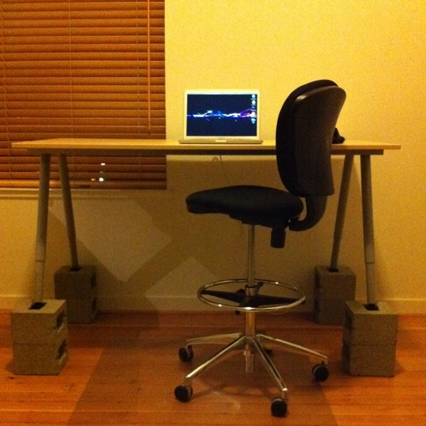 desk from ikea galant and concrete blocks safco drafting stool