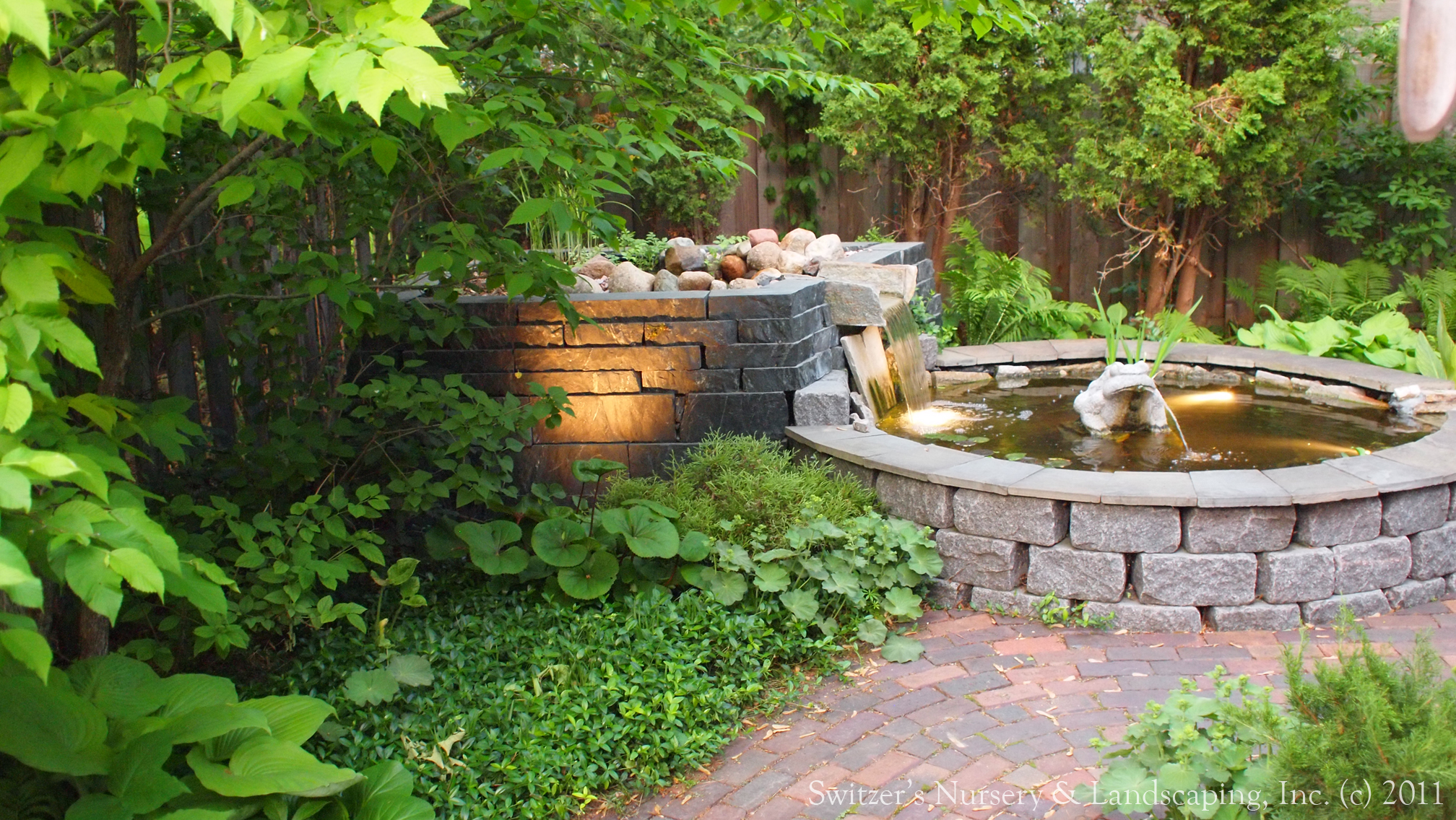 Minnesota landscape design inspired by bali natural for Raised pond design
