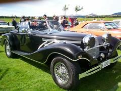 race car, automobile, vehicle, mercedes-benz 500k, antique car, classic car, vintage car, land vehicle, luxury vehicle, convertible, sports car,