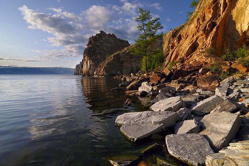 sunset summer lake clouds landscape geotagged russia dusk stones siberia 2009 baikal burhan olkhon watermirror nikond300 tokinaaf12244 irkutskoblast burhancape
