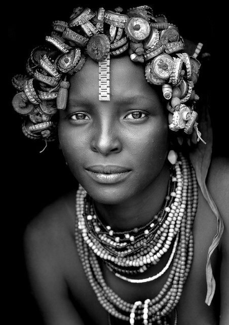 Daasanach tribe girl with a wig made of bottle caps on the head - Omorate Ethiopia