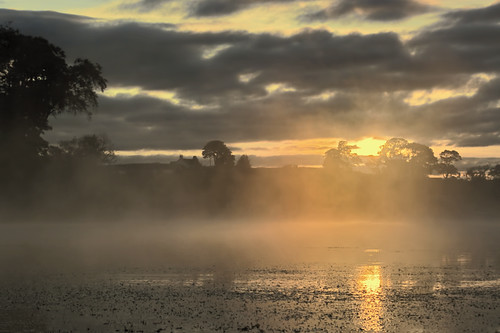misty sunrise over scottish loch