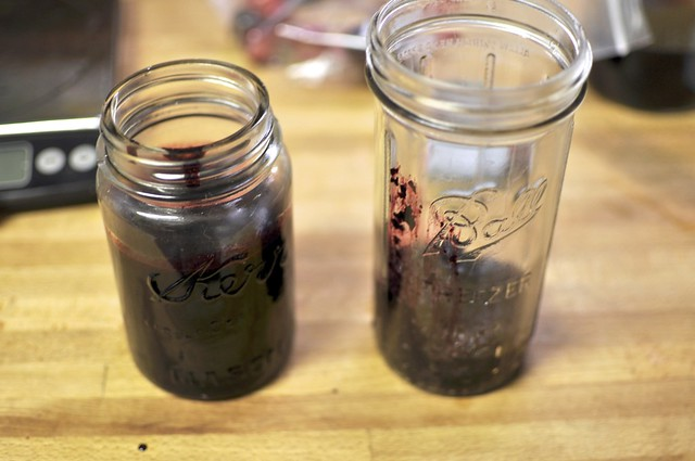 black raspberry syrup on left, seedy remains on right