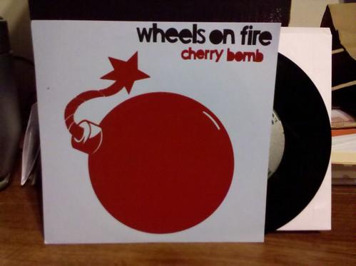 "Wheels On Fire - Cherry Bomb 7"""