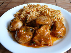 fried food(0.0), gravy(1.0), meal(1.0), curry(1.0), chicken meat(1.0), orange chicken(1.0), meat(1.0), produce(1.0), food(1.0), dish(1.0), cuisine(1.0),