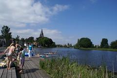 Zwemmende kinderen in de Amstel