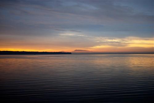 ocean orange canada rock clouds sunrise island washington bc amtrak ripples