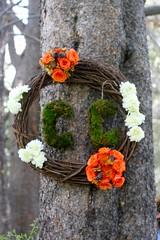 decor(0.0), plant(0.0), christmas decoration(0.0), autumn(0.0), flower arranging(1.0), flower(1.0), branch(1.0), leaf(1.0), tree(1.0), floral design(1.0), floristry(1.0), wreath(1.0),