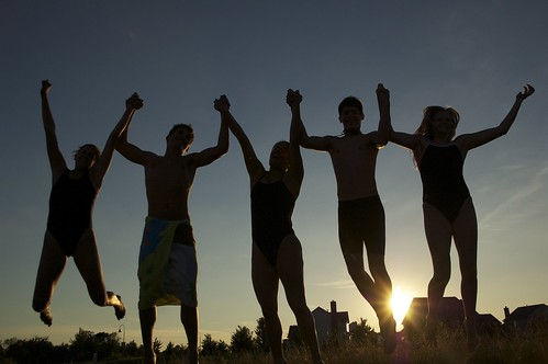girls friends sunset boys silhouette kids jumping holding hands raw excited teenager holdinghands