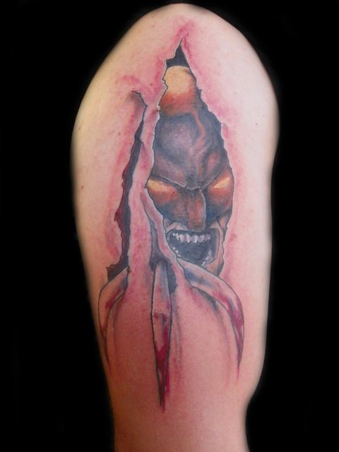 wolverine tear out tattoo