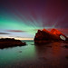 Northern Lights behind Bow Fiddle Rock, Moray, Scotland by Kenny Muir