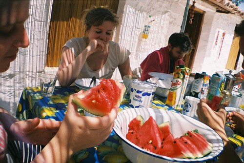 enjoying watermelon
