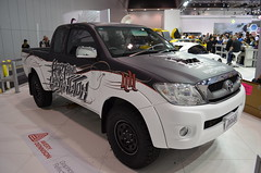 compact sport utility vehicle(0.0), automobile(1.0), automotive exterior(1.0), toyota(1.0), pickup truck(1.0), vehicle(1.0), truck(1.0), toyota hilux(1.0), off-roading(1.0), auto show(1.0), bumper(1.0), land vehicle(1.0),