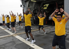 "PACIFIC OCEAN (June 13, 2011) – Sailors PT on the flight deck aboard the Ticonderoga-class guided-missile cruiser USS Cowpens (CG 63) as part of the ""Chiefs in Training"" program. (U.S. Navy photo by Mass Communication Specialist 1st Class N. Ross Taylor)"