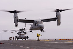 PACIFIC OCEAN (July 28, 2011) An MV-22 Osprey lifts off from the flight deck of amphibious assault ship USS Bonhomme Richard (LHD 6).  This is the first time an Osprey has operated from the newly upgraded ship. (U.S. Navy photo by Senior Chief Mass Communication Specialist Joe Kane)