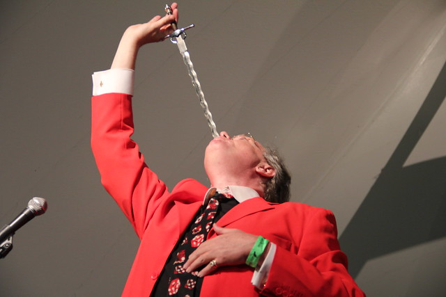 Robbins & Ringold sword swallowing at 2011 Chile Pepper Fiesta. Photo by Rebecca Bullene.