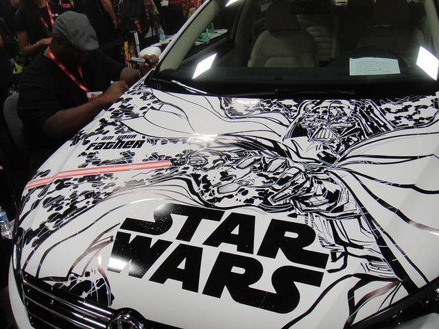 San Diego Comic-Con 2011 - artist Ken Lashley (top left) continues to add artwork to the VW Passat (Lucasfilm booth)