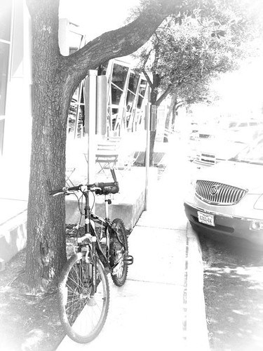 blackandwhite bw tree bike bicycle sign cycling buick san texas cyclist sidewalk angelo grayscale greyscale sanangelo tomgreen mountianbike bicycleparking 2011 blackwhitephotos tomgreenlibrary