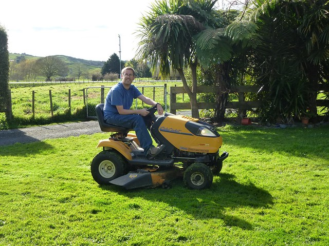 John hard at work mowing the lawn