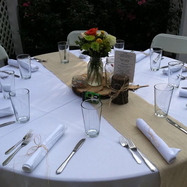 Wedding table setting with burlap birdseed and wood DIY wedding