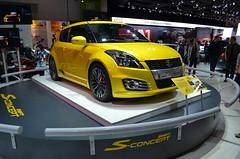 automobile(1.0), automotive exterior(1.0), exhibition(1.0), wheel(1.0), vehicle(1.0), automotive design(1.0), suzuki swift(1.0), auto show(1.0), city car(1.0), bumper(1.0), land vehicle(1.0), hatchback(1.0),