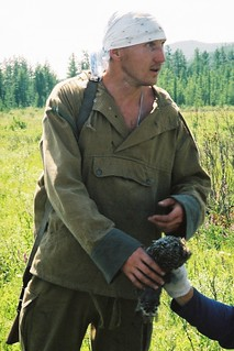 Siberian guide back from a hunt