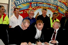 TWU National Secretary Tony Sheldon and Linfox CEO Michael Byrne signing the agreement