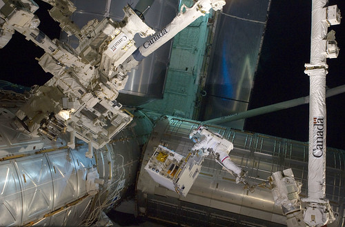 Astronaut Mike Fossum Transfers the Robotics Refueling Mission Payload During A Spacewalk on July 12, 2011