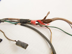 electronic device(0.0), rein(0.0), cable(1.0), wire(1.0), electrical wiring(1.0),