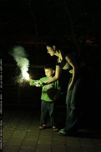 rachel helps sequoia with a sparkler