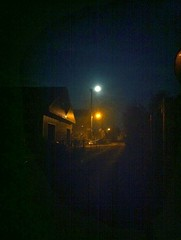 Streetlights and the moon.