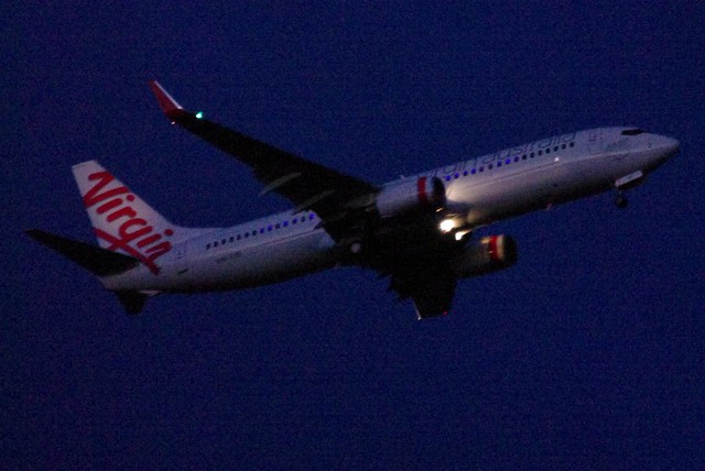 Virgin Australia Plane Flying in At Sunset With Lights