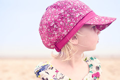 hairstyle(0.0), pattern(1.0), magenta(1.0), clothing(1.0), purple(1.0), head(1.0), sun hat(1.0), hat(1.0), cap(1.0), pink(1.0), headgear(1.0),