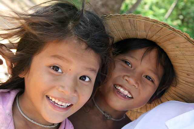Portrait of a smiling boy and girl in Cambodia.