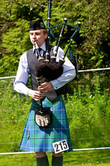 archery(0.0), weight training(0.0), bow and arrow(0.0), kilt(1.0), costume(1.0), bagpipes(1.0),