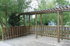 handrail(0.0), gate(0.0), real estate(0.0), outdoor structure(1.0), baluster(1.0), picket fence(1.0), pergola(1.0), deck(1.0),