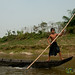 Boy Driving Boat on Shangu River - Bandarban, Bangladesh