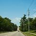 Small photo of Iowan road. Blue skies inbetween today