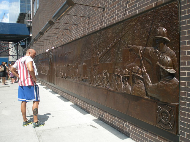 Man stopping to view a 9/11 memorial plaque