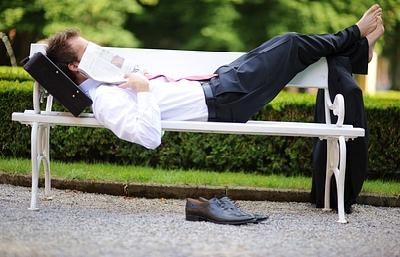 Young Businessman Lying in the Park