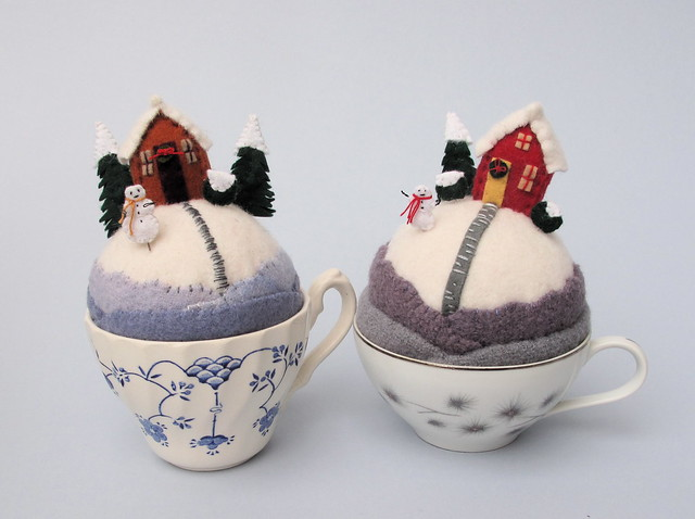 2 snowy tiny world pincushions