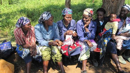 Women in Meru, Kenya, examining Menstrual Cups