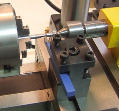 wheel(0.0), machine(1.0), metal lathe(1.0), tool(1.0), tool and cutter grinder(1.0), machine tool(1.0), lathe(1.0),