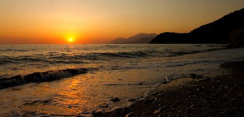 sunset sea mountains beach water stone landscape sand waves albania adriaticsea
