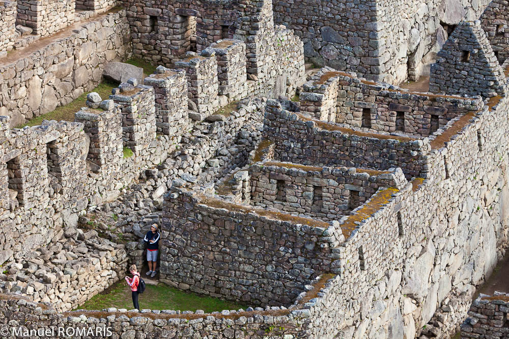 Machu Picchu, Peru, two tourists explore the ruins