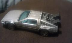 race car, model car, automobile, vehicle, delorean dmc-12, scale model, land vehicle, supercar, toy, sports car,