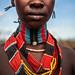 portrait hamer tribe girlfriends are wearing heavy necklaces, leathers embellished with seashells and colored beads, bracelets made ​​of iron and copper-lower omo valley-ethiopia.