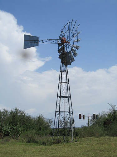 The windmill that pumps water from Lake Victoria to the home