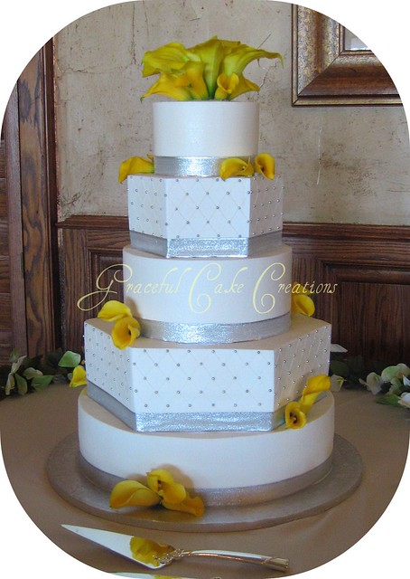 Elegant White and Silver Wedding Cake with Yellow Calla Lilies