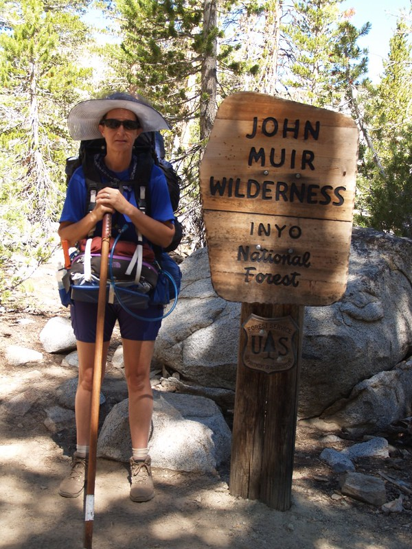 Vicki at the John Muir Wilderness sign on the Bishop Pass Trail